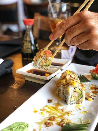 Sushi dip. Sushi Appetizer Chopsticks Seafood Human Hand Close-up Sashimi  Served Soy Sauce Prawn Tuna Soybean Shrimp Salmon - Seafood Tofu Scallop Japanese Food Ginger Rice - Food Staple Prepared Food Spring Roll Kebab Fried Rice Caviar Shrimp - Seafood Salmon