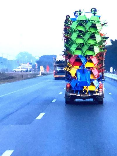 Transportation Land Vehicle Road City Mode Of Transportation Street Sky Motor Vehicle Day No People Architecture Nature Car Outdoors Truck Commercial Land Vehicle Clear Sky Motion Built Structure Sign