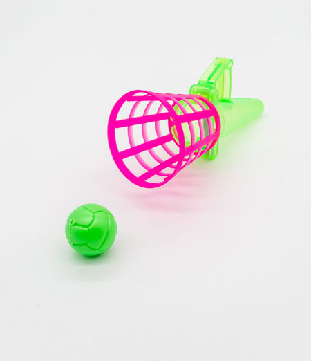 Close-up of toy over white background
