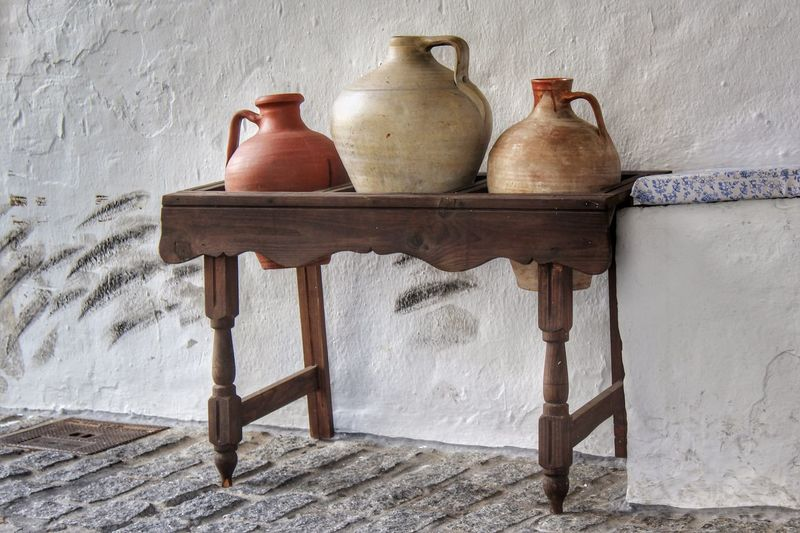 Pottery On Table Against Wall