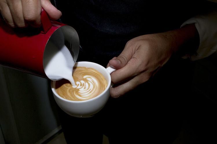 Barista pouring milk in coffee cup for make latte art. Barista Cappuccino Coffee Coffee - Drink Coffee Cup Coffee Shop Cup Drink Food And Drink Froth Art Frothy Drink Hand Holding Hot Drink Human Hand Indoors  Latte Mug One Person Real People Refreshment