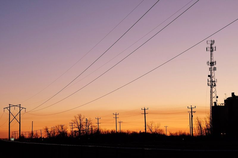 Colour of sky. Wires Power Grid Cable Sunset Electricity  Power Line  Power Supply Electricity Pylon Fuel And Power Generation Connection Outdoors Sky Electricity Tower Silhouette Technology Nature Beauty In Nature Autumn Sunset Silhouettes Mauve  Dusk Tranquil Scene Canada Calm Clear Sky Crépuscule Cell Tower Silhouette Built Structure