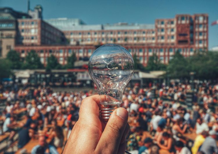 Lamp Crowd 2019 Niklas Storm Juni Human Hand Holding Crowd Close-up Sky Human Finger Building Residential Structure The Photojournalist - 2019 EyeEm Awards My Best Photo The Street Photographer - 2019 EyeEm Awards