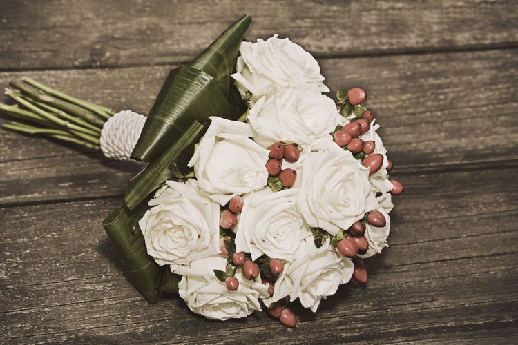 bridal bouquet with beautiful rose flowers on wood Wedding Wedding Photography Wedding Day Bridal Bride Wife Woman Table Indoors  No People Bridal Bouquet Bouquet Bride Flower Flower Photography Flowers Ceremony Roses Bouquet Roses