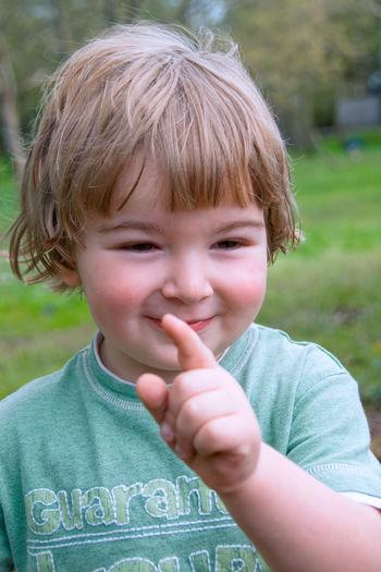 Portrait of cute boy gesturing