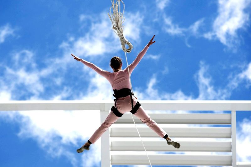 woman hanging on a rope on a building, sky in the background Sky Show Lifestyles Nikon Nikonphotography Blue Cloud - Sky Sportsman Athlete Basketball - Sport Competitive Sport Sport Men Flexibility Basketball Hoop Exercising Blue International Women's Day 2019 My Best Photo The Art Of Street Photography Exploring Fun