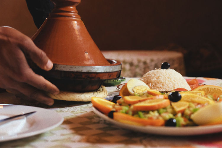 Tagine in the Sahara Desert Moroccan Food Morocco Sahara Desert Close-up Finger Food Food And Drink Freshness Fruit Hand Healthy Eating Human Body Part Human Hand Indoors  Lifestyles Midsection One Person Plate Real People Selective Focus Table Tagine  Traditional Food Unrecognizable Person Wellbeing