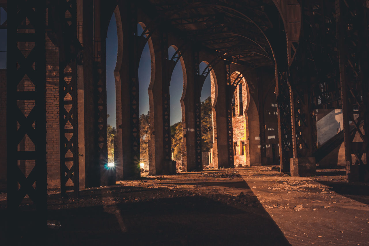 architecture, building, arch, built structure, the way forward, place of worship, history, indoors, the past, religion, architectural column, no people, belief, spirituality, illuminated, direction, night, arcade, colonnade