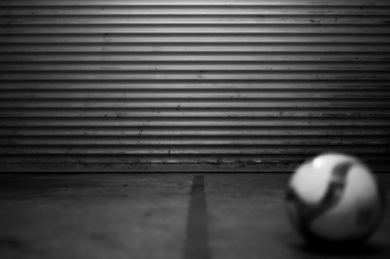 the ball was lying and I just shot a test photo... Black & White EyeEmNewHere Football LINE Lines Backgrounds, Beauty, Blue, Bright, Climate, Flower, Garden, Green, Landscape, Leaf, Life, Nature, Park, River, Scene, Scenics, Side, Sky, Spray, Stone, Summer, Sunlight, Travel, Tree, Tropical, Turkey, View, Water, Waterfall, Wet Ball Black And White Blackandwhite Blackandwhite Photography Blurred Motion Close Up Close-up Closeup Corrugated Iron darkness and light Day Indoors  Lines And Shapes One Person People Real People Scene Shadow White And Black
