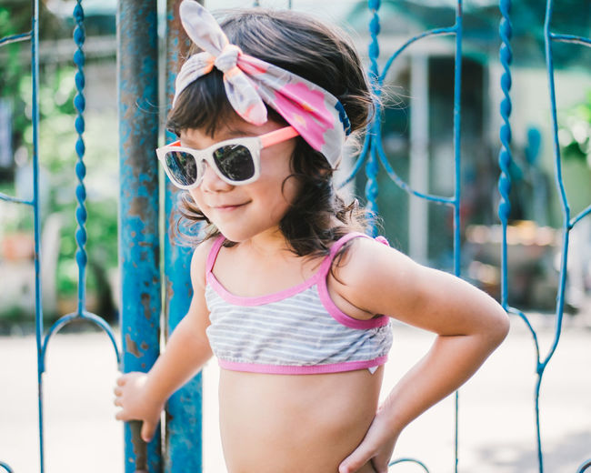 Girl wearing sunglasses standing outdoors