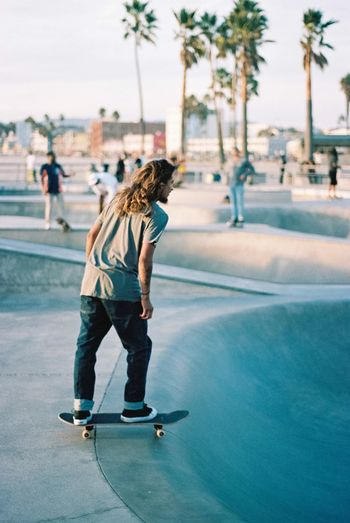 Skater in Venice Beach Real People Full Length Leisure Activity Incidental People Lifestyles Focus On Foreground One Person Skateboard Outdoors Day Casual Clothing Balance Built Structure Motion Skateboard Park Architecture Childhood Building Exterior Tree Young Adult Film Photography 35mm Film Kodak
