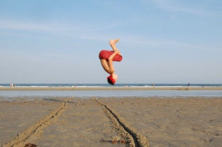 Sea Beach One Person Water Mid-air Horizon Over Water Sky Flip High Noon Summer Good Vibes