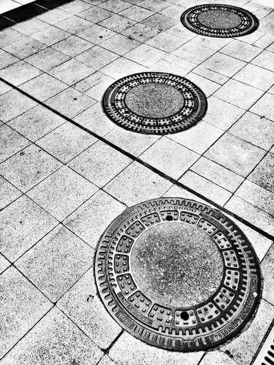 Black & White Manhole  Circles Three Is The Magic Number