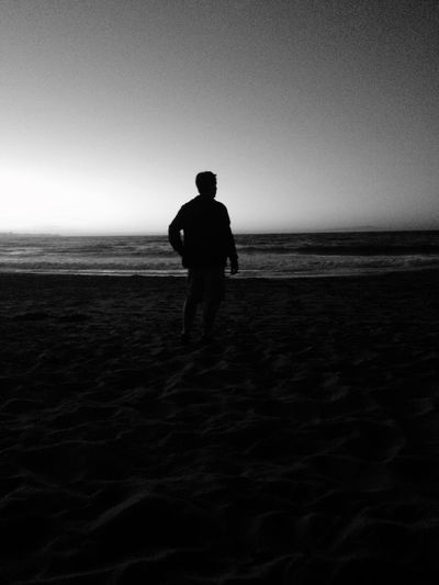 My husband standing at the beach Black And White Husband Monterey Bay Del Monte Del Monte Beach Real People Land Sky Beach Sea Horizon Over Water Horizon One Person Beauty In Nature Nature Full Length Water Scenics - Nature Lifestyles Men Silhouette Rear View Leisure Activity Sand