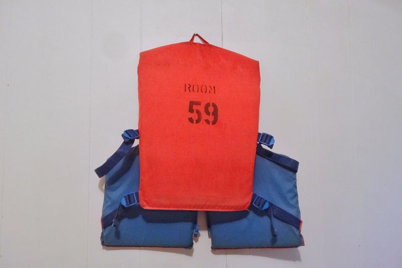Vintage life jacket 'Room 59' Red No People Close-up Indoors  Life Jacket Flotation Device Emergency Device Life Guard Boating Equipment Words Numbers Letters Room 59 Vintage Vintage Life Jacket