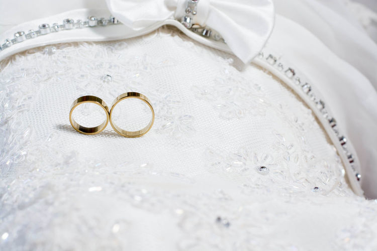 Close-Up Of Rings On Textile