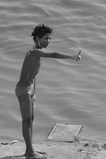 """(Sorry for publishing the same photo, it's to participate to the """"Visual Creativity"""" mission. Shall delete one later...) Ganges River Visual Creativity Angry Boy Boy Shouting Loud Expressive Face Indian Lifestyle.. One Person Outdoors Real Life River Bath"""