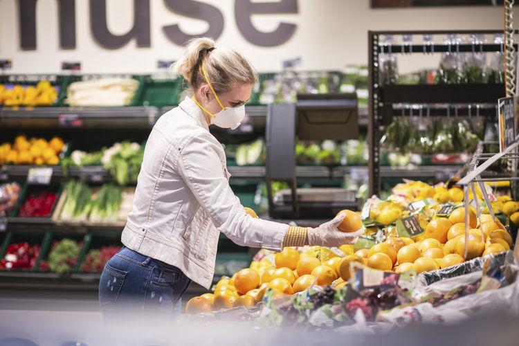 Woman eating food at market