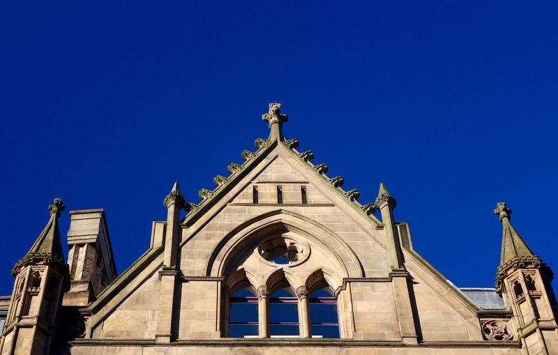 Victorian Architecture Cityscape Gothic Manchester Victorian Architecture Bell Tower Blue Blue Sky Building Exterior Built Structure Clear Sky Cross Day Haert Heritage Heritage Building Low Angle View No People Outdoors Place Of Worship Religion Sky Spirituality Triangle