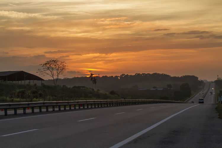 Highway in the sunset Beauty In Nature Cloud - Sky Day Destination Highway Landscape Nature No People Outdoors Pathway Road Scenics Sky Sunrise Sunset The Way Forward Transportation Way