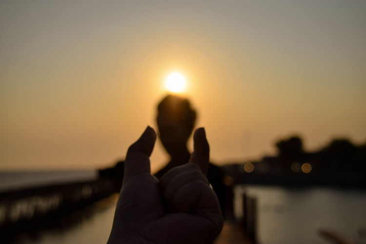 Low Section Water Sunset Beach Sea Human Leg Reflection Personal Perspective Sky Close-up Shining Sun Sunbeam Sky Only