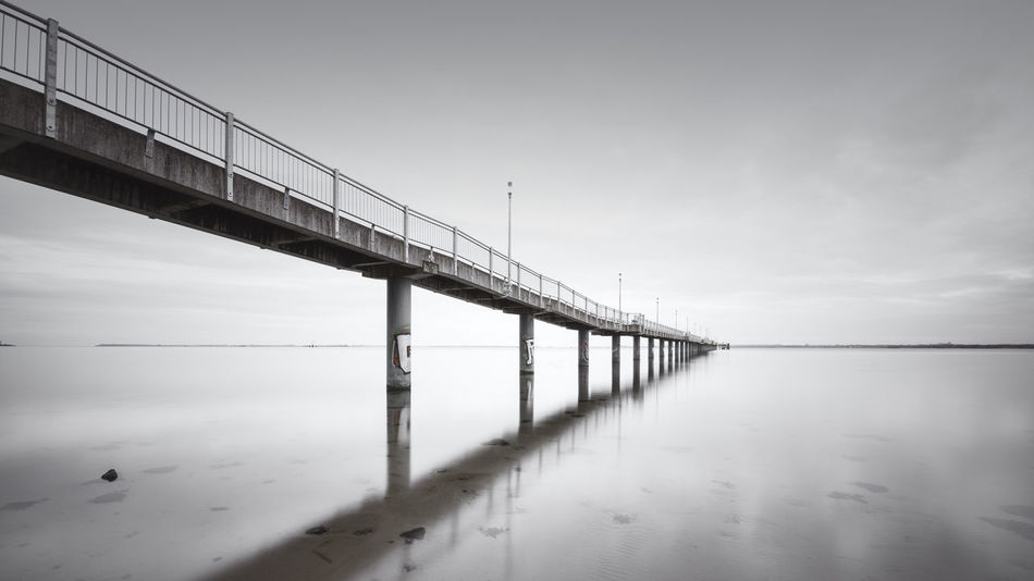bridge over water against sky Baltic Baltic Sea Mecklenburg-Vorpommern Winter Wintertime Architecture Bridge - Man Made Structure Built Structure Cold Cold Days Cold Temperature Connection Day Fine Art Landscape Long Exposure Muted Colors Nature Naturelovers No People Ocean Outdoors Philipp Dase Sea Sea And Sky Seascape Sky Transportation Water Wismar Shades Of Winter