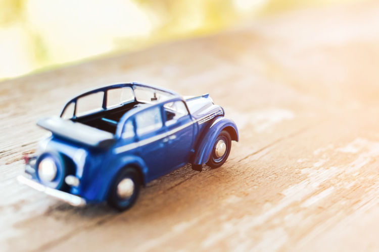 Selective Focus Wood - Material Toy Car Table Blue Close-up Car Toy Indoors  Childhood Still Life Motor Vehicle Mode Of Transportation Plastic Transportation Day Single Object Flooring