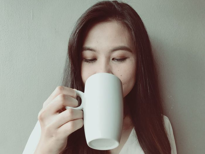 Close-Up Of A Woman Drinking Coffee