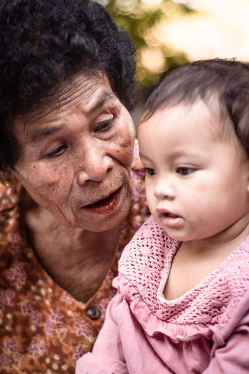 Close-Up Of Grandmother With Granddaughter