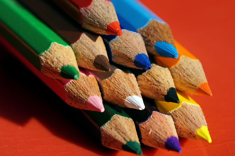 Multi Colored Wood - Material Indoors  No People Still Life Close-up Pencil Writing Instrument Art And Craft Colored Pencil Large Group Of Objects Craft Variation Creativity Table Studio Shot Focus On Foreground Arrangement Red Flame Art And Craft Equipment Matchstick