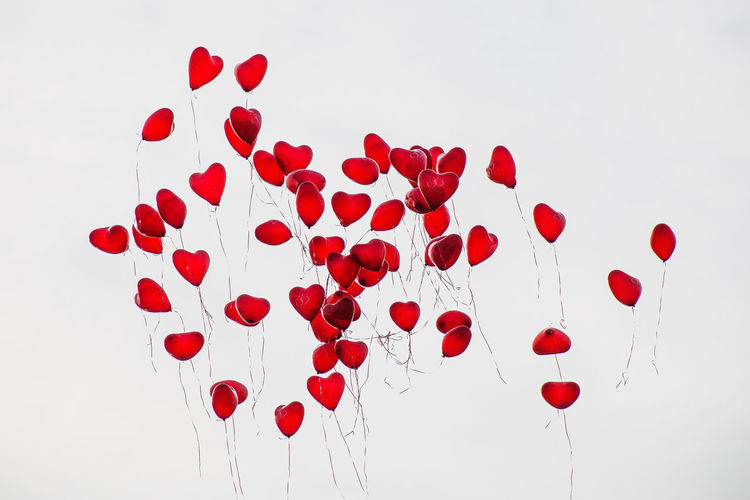 Celebration Day Flying Heart Shape Helium Large Group Of Objects Love Low Angle View Nature No People Outdoors Red Romance Sky Studio Shot Traditional Festival Valentine's Day - Holiday
