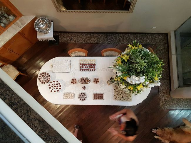 My dog observes while my sister prepares the table for my parents' golden anniversary toast. Champagne, bon bons and chocolates truffles and all that good stuff. Beautifully Organized Table Decoration Tabletop Tabletop Shot Chocolate Bonbons Flowers On Table Goldenanniversary 50yearstogether Love Is In The Air Dog Lurking View From Above Enjoy The New Normal waiting game Food Stories