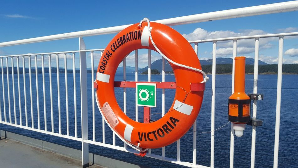 EyeEm Selects No People Outdoors Water Buoy Security Boat Deck Safety Ferry Ride Lifering Protection Life Belt Orange Blue Sky Sun Light Communication British Columbia, Canada BC Ferries Mountains Looking Through Peaceful View Calm Water Calm
