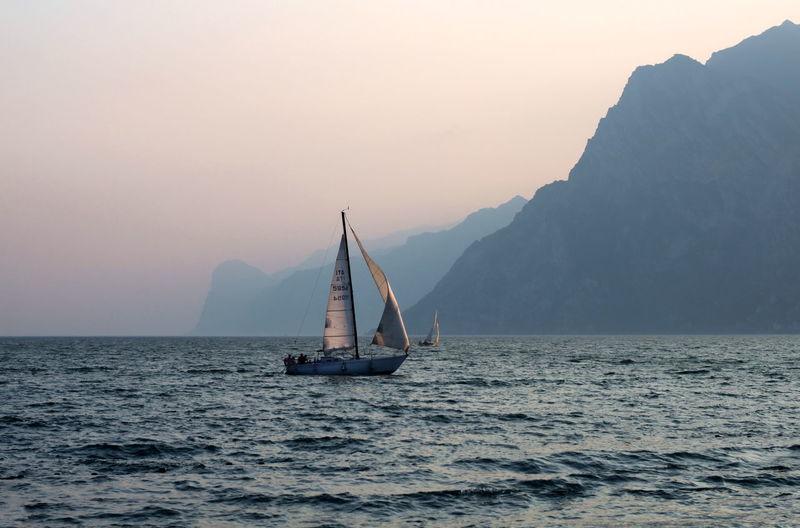 Boat Sailing On Sea Against Foggy Sky
