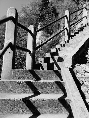 Upstairs Shadow Railing Stairs Stairs & Shadows Outdoors Architecture Built Structure Black&white Eyem Masterclass High Angle View High Contrast Low Angle View Shadows & Lights Shadow And Light Shadow Photography Shadows On The Wall Shadow-art