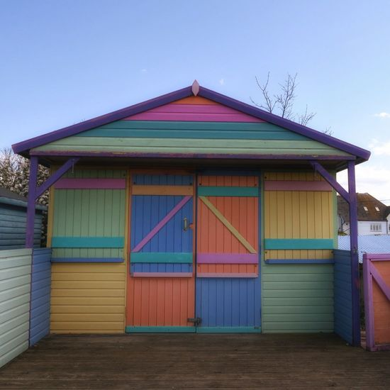 Colourful beach hut in Whitstable Kent England Built Structure Beach Day Architecture Sand Outdoors No People Building Exterior Multi Colored Sky