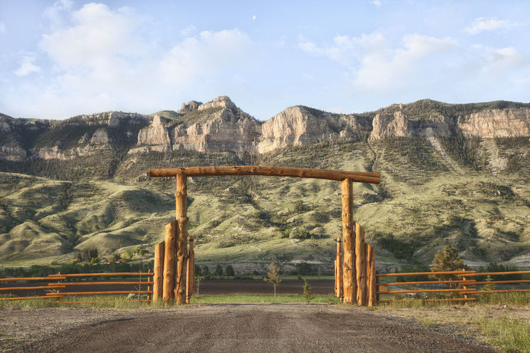 Ranch gate below cliffs in western Wyoming Cliffs Cloud - Sky Day Fence Hill No People Non Urban Scene Ranch Gate Rock Formation USA West Wyoming