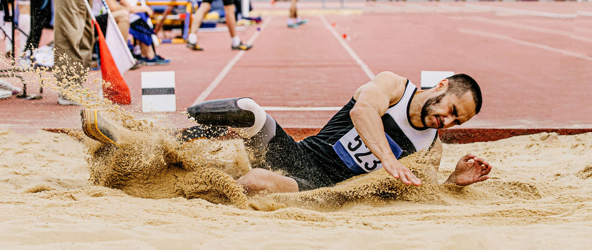 Athlete suffering from amputee long jumping