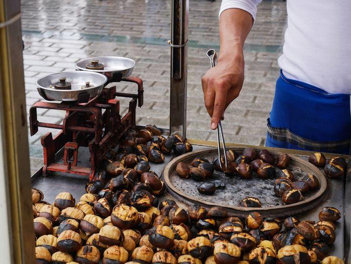 Man Preparing Food At Street