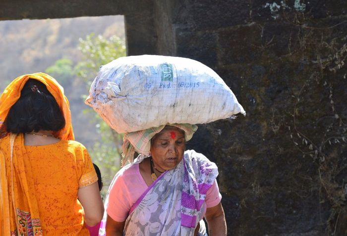 At this age when a person dreams of living under their childrens' care these old women on Sinhagad fort work hard to earn some food for themselves and their husbands.. Hardwork Oldwomen India Sinhagadfort🏰