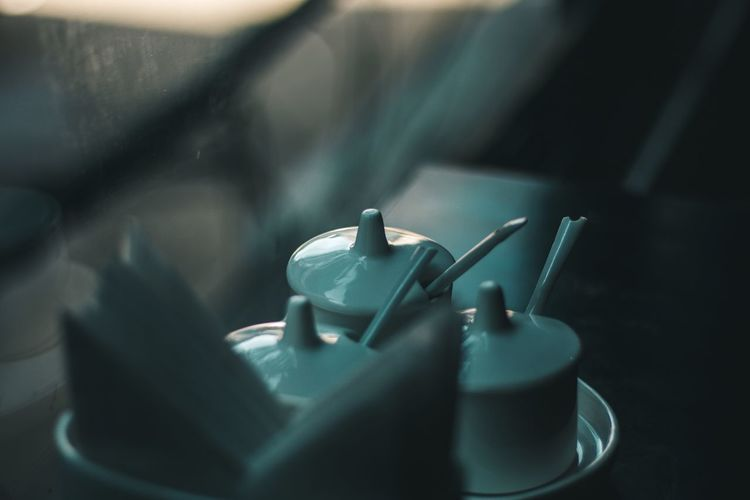 Close-up of cups on table