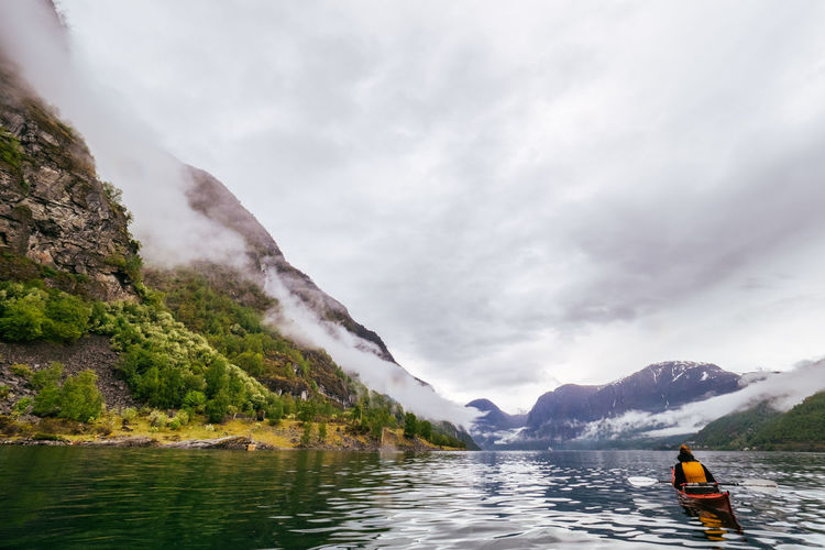 Adult Adults Only Adventure Beauty In Nature Cloud - Sky Day Epic Fjord Kayak Lake Landscape Mountain Nature Nautical Vessel Norway Outdoors People Scandinavia Scenics Sky Vacations Water