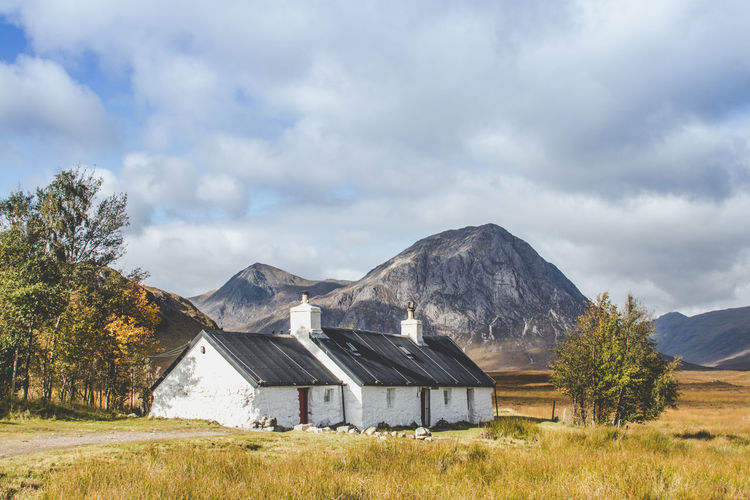 Not a bad spot to live! Sky Mountain Plant Cloud - Sky Architecture Environment Built Structure Landscape Building Exterior Land Nature Grass Scenics - Nature Tree No People Beauty In Nature House Day Agricultural Building Field Mountain Range Outdoors Cottage Glencoe Scotland