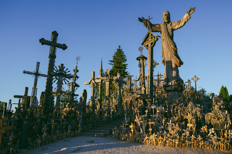 The Hill of Crosses Hill Of Crosses Lietuva Statue Architecture Clear Sky Day No People Outdoors Pilgrims Religion Sculpture Sky Spirituality Statue The Hill Of Crosses Tourism Travel Destination Tree Unesco Visiting