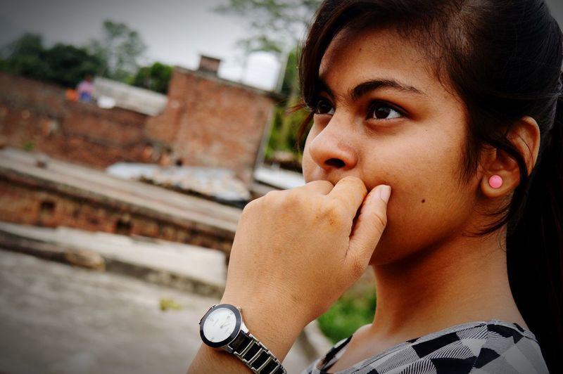 Close-up of thoughtful teenage girl looking away