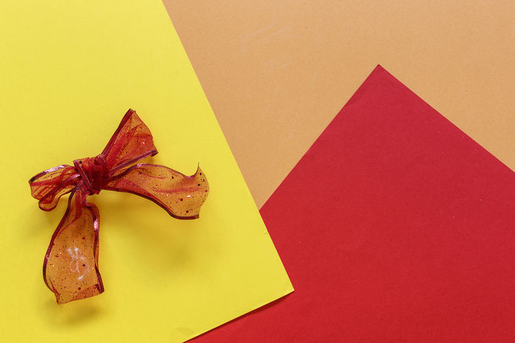 Art And Craft Blank Brown Close-up Colored Background Copy Space Craft Creativity High Angle View Indoors  No People Paper Pattern Red Shape Single Object Star Shape Still Life Studio Shot Table Yellow