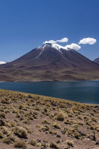 miscanti volcano with snow and its lagoon at andes mountain range Atacama Desert Chile Cloud Miscanti Lagoon Atacama Blue Lagoon Lake Miscanti Mountain Mountain Range Snow Volcano