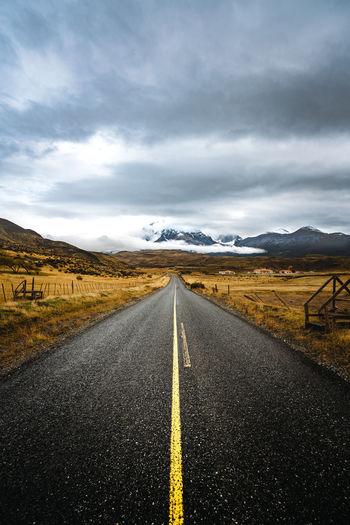 Check out my prints at https://simonmigaj.com/shop/ and visit my IG http://www.instagram.com/simonmigaj for more inspirational photography from around the world. Patagonia Chile Torres Del Paine Travel Landscape Mountain Road Road Sign Straight Sky Landscape Cloud - Sky Mountain Range Empty Road Country Road Yellow Line Countryside Tire Track Road Marking Mountain Road Diminishing Perspective
