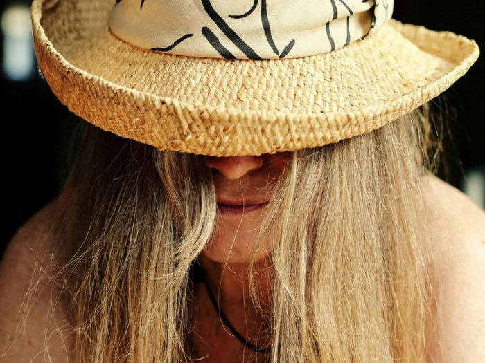 Close-up portrait of woman in hat