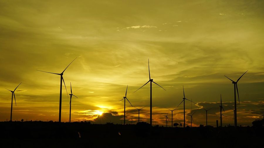 Fuel And Power Generation Alternative Energy Wind Turbine Environmental Conservation Renewable Energy Sunset Wind Power Windmill Silhouette Sun Environment Scenics Cloud Majestic Sky Rural Scene Tranquil Scene Tranquility Orange Color